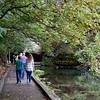Visitors tour the large pool at the Roaring River fish hatchery on Friday.<br /> Globe   Roger Nomer