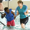 From the left: Triathlete Vanessa Workman and personal assistant Angela Covington exit the pool after therapy on Friday at the Neosho Freeman Family YMCA. Workman is training to compete Sunday in St. Louis at the Tri My Best Adaptive Triathlon.<br /> Globe | Laurie SIsk