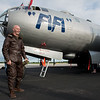 "Brad Eichelberger, Joplin, laughs as he exits the cockpit of the B-29 Bomber ""Fifi"" on Monday at the Joplin Regional Airport. Eichelberger wore an original WWII Navy pilot uniform for the visit to the bomber.<br /> Globe 