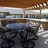 From the left: Redwood Gardens Property manager Kim Jones and coowner Eric Schroeder chat outside in the large community outdoor kitchen on Wednesday at the senior housing development.<br /> Globe | Laurie Sisk