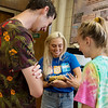 (from left) Kevin O'Boyle, a Pittsburg State sophomore from Lenexa, Lakynne McElroy, a PSU senior from Erie, and Jennifer Gee, PSU junior fro Pittsburg, check out a bearded dragon on Tuesday at PSU's Nature Reach.<br /> Globe | Roger Nomer