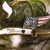 A commemorative knife with an insert of a piece of steel from the World Trade Center rests on a calendar of 911 heroes as part of a display of Sept. 11 artifacts and memorabilia at SMB Bank on North Main Street.<br /> Globe | Laurie Sisk
