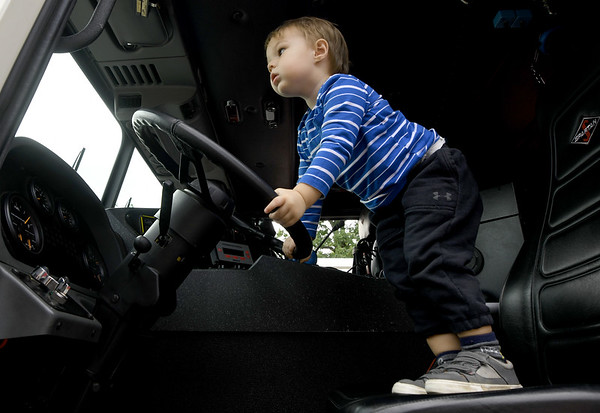 Two-year=old Eli Staples mans the wheel of a firetruck during the Redings Mill Fire District's 40th Anniversary event on Saturday at the RMFD.<br /> Globe | Laurie Sisk