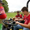 From the left: Seneca students Aidan Brown, Landon Brown and Christopher Alexander check out a John Deere tractor supplied by Legacy Farm and Lawn on Thursday at the University of Missouri Southwest Research Center near Mount Vernon.  <br /> Globe | Laurie Sisk