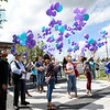 Participants of the Ozark Center's Break the Code of Silence suicide awareness event release 540 teal and blue balloons in remembrance of area suicide victims and their loved ones on Friday at the Joplin Public Library. The teal balloons represent the 51 suicides in the four county area of Jasper, Newton, McDonald and Barry counties in 2016, while the blue balloons represent the average number of lives directly affected by each suicide.<br /> Globe | Laurie Sisk
