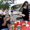 From the left: Matt Dutton and Leslie Hines treat their one-year-old twins Remi and Jace Dutton to snacks during the Freeman Health System and Children's Miracle Network Hospitals 5th Annual NICU Reunion on Saturday at Freeman. The Dutton twins spent the first two and a half months of their lives in the NICU at Freeman and are now thriving, active young toddlers.<br /> Globe | Laurie Sisk