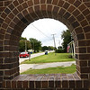 Traffic passes by the bricked arches of an old train depot in the community of Oronogo last week.<br /> Globe | Laurie Sisk
