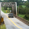 A truck travels over a bridge on Highway D over Center Creek on Thursday.<br /> Globe | Roger Nomer