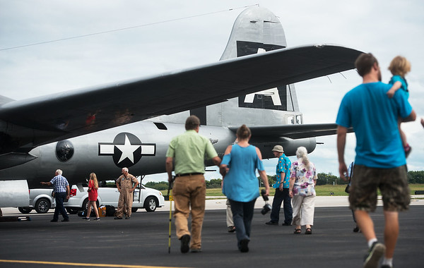 """Visitors take a tour of the B-29 Bomber """"Fifi"""" at the Joplin Regional Airport on Monday.<br /> Globe 