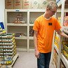 Wyatt Williams, a missionary with the Church of Jesus Christ of Latter Day Saints from Blackfoot, Idaho, volunteers at the Wesley House food pantry on Tuesday in Pittsburg.<br /> Globe | Roger Nomer