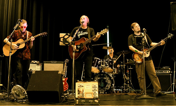 Members of the Neosho-based band The Grays entertain guests at the 9th Annual Joplin BeerFest, a benefit for Big Brothers Big Sisters Jasper/Newton Counties. The event featured a wide selection of beers, food, door prizes and a silent auction.<br /> Globe | Laurie Sisk