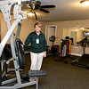 From the left: Redwood Gardens Property manager Kim Jones stands inside one of two gyms on Wednesday at the senior housing development.<br /> Globe | Laurie Sisk