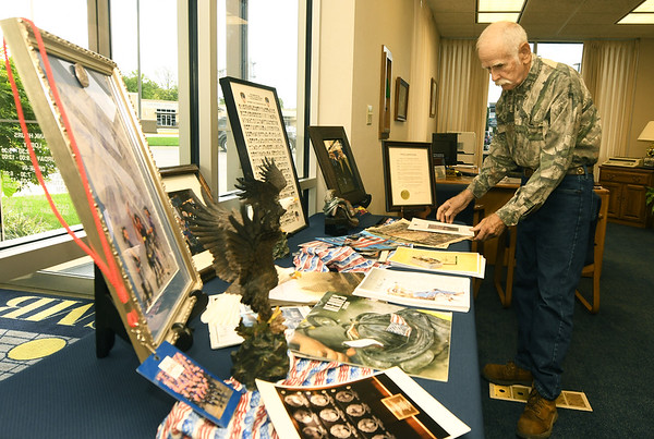 On Monday, local artist Larry Glaze organizes a display of artifacts and memorabilia at SMB Bank on North Main Street from the Sept. 11, 2001 attacks on the World Trade Center. The display includes a metal scrap from one of the twin towers and numerous photographs of the first squad of firefighters to arrive on the scene.<br /> Globe | Laurie Sisk