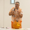 Scott Norman talks about pumpkin carving at the Joplin Public Library on Wednesday.<br /> Globe | Roger Nomer