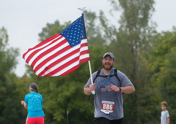 Darrel Dinger, Joplin, finishes the half-marathon race of Sunday's Mother Road Marathon in Joplin.<br /> Globe | Roger Nomer