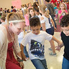 Nikki Allen, second grade teacher at Columbia Elementary, dances with Finn, center, and Sid Hoskins, first graders, during the school's Sock Hop on Thursday.<br /> Globe | Roger Nomer