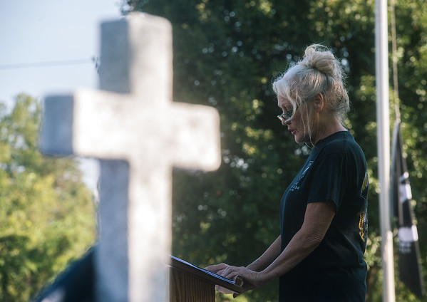 Debb Ollis, VFW auxiliary member, reads names of those killed on Sept. 11, 2011, at the Joplin VFW on Wednesday.<br /> Globe   Roger Nomer