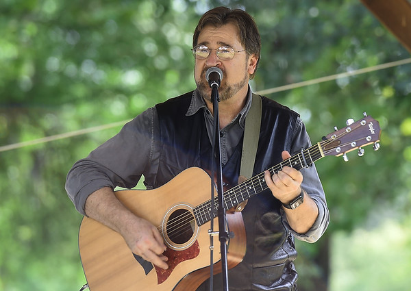 Guitarist Jerry Bahr, of the Workman Bluegrass Band, entertains the crowd during the Carl Junction Bluegrass Festival on Saturday at Center Creek Park. Bahr and his band were one of several performing at the annual event.<br /> Globe | Laurie Sisk