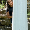 "Arely Avitua stands in behind a column at Big Spring Park in Neosho on Wednesday. Avitua recently was the youngest cast member of the MTV-produced reality show, ""The Real World.""<br /> Globe 