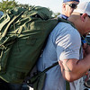 Some ruck sacks can weigh upwards of 50 pounds, like the one carried by Enrique Medina on Monday.<br /> Globe | Roger Nomer
