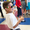 Evan Horton, third grader at Columbia Elementary, dances during the school's Sock Hop on Thursday.<br /> Globe | Roger Nomer