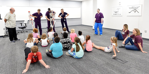 West Central Elemetary students get a crash course in anatomy from Kansas City University students during KCU's Score 1 for Health event on Tuesday at KCU. The children's preventative screening program involved about 130 West Central Elementary students and included basic health screenings and educational presentations for the kids.<br /> Globe | Laurie Sisk