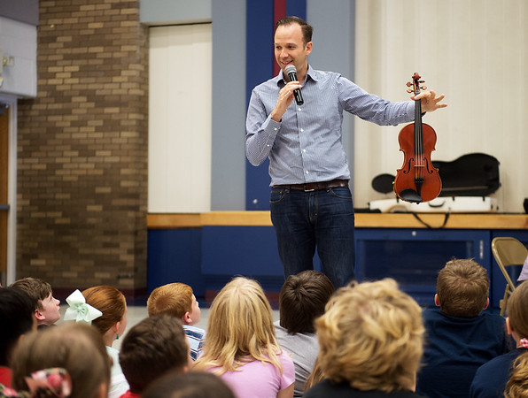 William Fedkenheuer talks with students at Cecil Floyd about his violin during a presentation on Wednesday.<br /> Globe | Roger Nomer