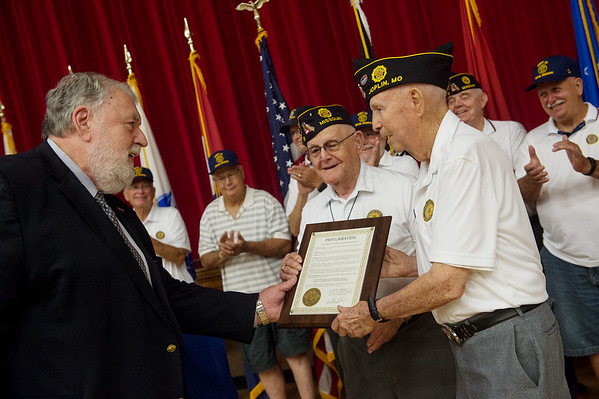 Joplin Mayor Gary Shaw presents a proclaimation to long-time American Legion Post 13 members John Newberry, center, and Ralph Green, Snr., during Thursday's Veterans Expo at Joplin Memorial Hall. The Legion is celebrating its 100th anniversary.<br /> Globe | Roger Nomer