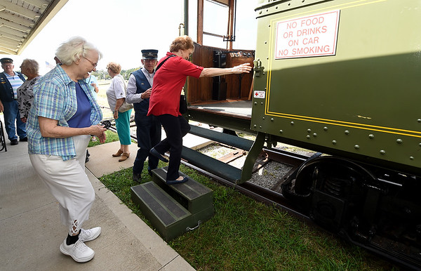 From the left: Louise Reed and Laveda Norton board Engine No. 42 as conductor Jum Dawson assists on Wednesday at King Jack Park in Webb City. Members of Joplin's First Methodist Church decided to ride the trolley as a fun activity to lighten their spirits on the anniversary of the Sept. 11, 2001 attacks.<br /> Globe | Laurie Sisk