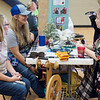 (from left) Martha Black and Rachel Cody, with the Fiber Folks of Southwest Missouri, talk with Kathryn Holz, Joplin High senior, during Thursday's Ag Day at Joplin High.<br /> Globe | Roger Nomer