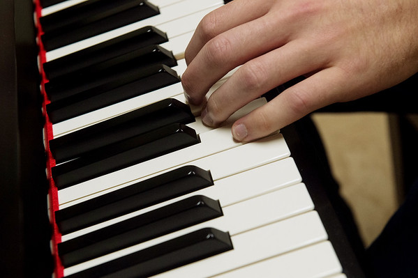 Joseph Fry, a Missouri Southern junior music education major, uses a Steinway practice piano on Wednesday at Missouri Southern.<br /> Globe | Roger Nomer