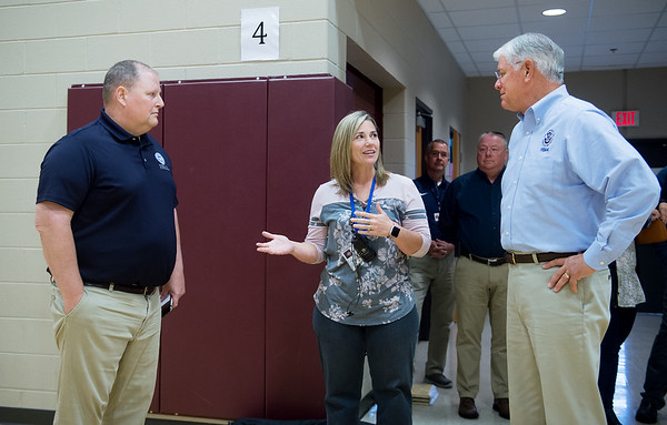 Julie Munn, principal at Kelsey Norman Elementary, talks with Paul Taylor, regional administrator for FEMA in Kansas City, left, and David Maurstad, director of the mitigation division for FEMA, about the school's saferoom on Tuesday.<br /> Globe | Roger Nomer
