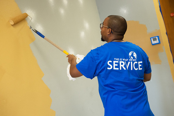 Deandre Tuggle, from the Kansas City chapter of the Phi Beta Sigma Fraternity, paints at the Community Service Center on Friday.<br /> Globe | Roger Nomer