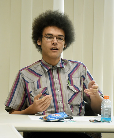 Eighteen-year-old julian Garrett discusses the topic of community policing during the inaugural Youth Council meeting on Wednesday night at Joplin City Hall. The council is made up of 11 teens from public and private schools in Joplin.<br /> Globe | Laurie Sisk