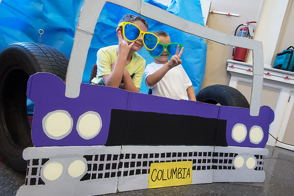 Caleb Benedict, left, and Landry Schwab, second graders at Columbia Elementary, pose for a photo during Thursday's Sock Hop at the school.<br /> Globe | Roger Nomer