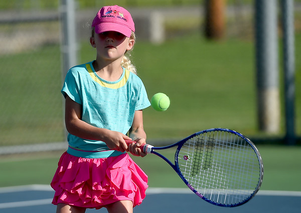 Aspiring tennis star Juliana Graham, 6, perfects her backhand on Wednesday at the Joplin Athletic Complex.<br /> Globe | Laurie Sisk