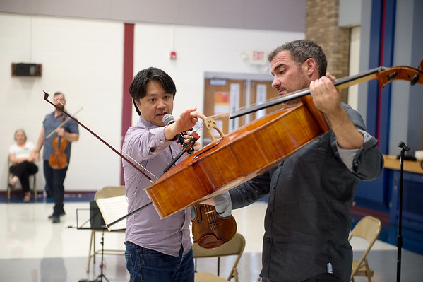 Daniel Ching, left, and Joshua Gindele talk about the structure of the cello during a presentation at Cecil Floyd on Wednesday.<br /> Globe | Roger Nomer