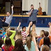 William Fedkenheuer, left, and John Largess ask students at Cecil Floyd Elementary if they play a musical instrument during a presentation on Wednesday.<br /> Globe | Roger Nomer