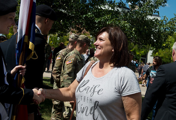 Cindy Webb, director of fitness at Missouri Southern State University, thanks memebers of the MSSU Show Me Gold program for their service following Wednesday's Sept. 11 rememberance on campus.<br /> Globe | Roger Nomer