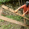 Jason Montgomery helps clear old lumber from a Webb City residence on Ball Street on Saturday. About 155 volunteers from God's Resort, Hearts & Hammers and Joplin Area Habitat for Humanity tackled 22 projects as part of a Brush With Kindness event.<br /> Globe | Laurie Sisk