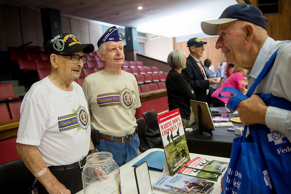 Gordon Freimark, Carterville, right, talks with Keith Fiscus, a World War II POW, left, and Robert Russow at the Military Order of the Purple Heart Chapter 821 booth during Thursday's Veterans Expo at Joplin Memorial Hall.<br /> Globe | Roger Nomer