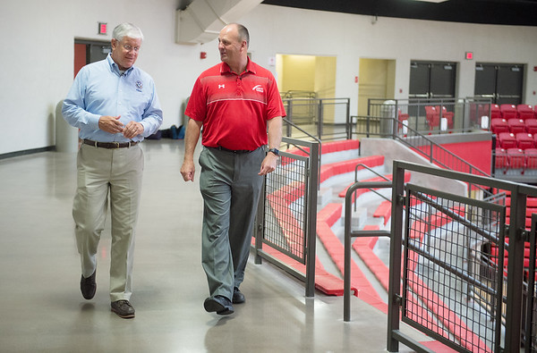 David Maurstad, director of the mitigation division for FEMA, left, gets a tour of the Webb City High School saferoom from Kevin Cooper, assistant superintendent, during a visit on Tuesday.<br /> Globe | Roger Nomer