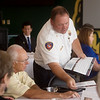 Joplin Fire Chief Jim Furgerson distributes information on Prop B to Rotary members during their meeting on Thursday at Missouri Southern.<br /> Globe | Roger Nomer