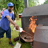 Quinterrio Jackson, of Jackson's BBQ, tends to his smoker on Saturday night during the annual Emancipation Park Days at Ewert Park. The three-day event featured music, games, food and more.