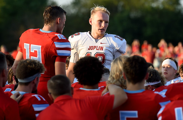 """We are rivals on the field, but family off the field,"" said Joplin quarterback Blake Tash, right, as he and Webb City quarterback Kade Hicks lead their teams in a pregame prayerbefore their game on Saturday night at Webb City.<br /> Globe 