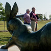 "John Kinkade, executive director of the National Sculptors' Guild, left, and Bob Headlee, chairman of the Rotary Sculpture Garden, talk about the ""Rabbit Reach"" sculpture in Mercy Park on Tuesday.<br /> Globe 