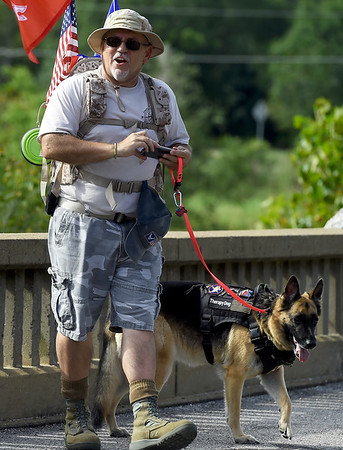 """Compass Quest Advocate Ted Donaldson and service dog Mya prepare for the start of the """"Let's Roll '19 Ruck March"""" on Saturday at Redings Mill Bridge. The event, sponsored by Compass Quest, included about 30 participants who hiked the 14-mile course to raise awareness concerning veteran's issues.<br /> Globe 