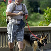 "Compass Quest Advocate Ted Donaldson and service dog Mya prepare for the start of the ""Let's Roll '19 Ruck March"" on Saturday at Redings Mill Bridge. The event, sponsored by Compass Quest, included about 30 participants who hiked the 14-mile course to raise awareness concerning veteran's issues.<br /> Globe 