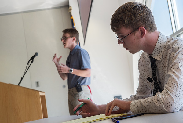 Colby Lane, left, and Mason Casey, both Crowder College freshmen from Neosho, engage in a Lincoln Douglas debate on executive privilege on Tuesday at the Neosho campus. The debate was held as part of the annual Constitution Day event.<br /> Globe | Roger Nomer