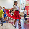 Lailah Namelo, fifth grader at Columbia Elementary, dances during the school's Sock Hop on Thursday.<br /> Globe | Roger Nomer